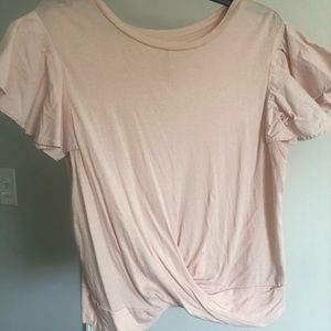Blush blouse with flutter sleeves and rouging.